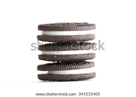 Chocolate cookies with cream filling on a white background. - stock photo