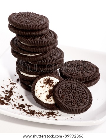 Chocolate cookies with creme filing - stock photo
