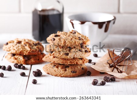 chocolate cookies with ingredients around - stock photo