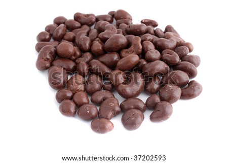 chocolate covered cashew nuts on a white background (not  isolated, short depth of field)