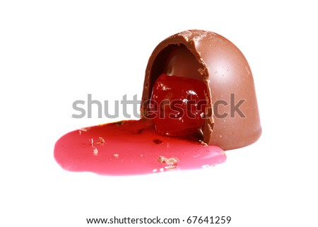 Chocolate covered cherry that has a bite taken out of it, so its juice flows out isolated on white with room for your text the perfect for valentines day images