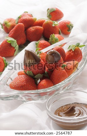 chocolate covered strawberries with dip - stock photo