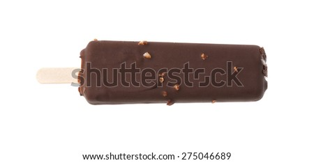 Chocolate covered vanilla ice cream bar with nuts on a wooden stick, isolated over the white background, top view above - stock photo