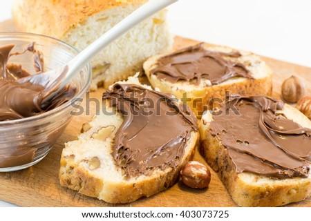 Chocolate cream on a homemade walnut bread slices - stock photo