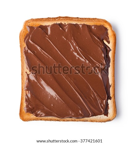Chocolate cream on a slice of Toast. Isolated on a white background - stock photo