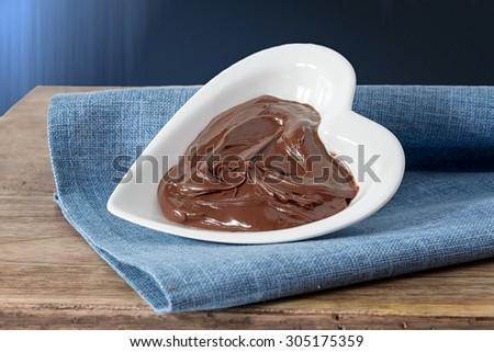 chocolate cream on heart bowl - stock photo