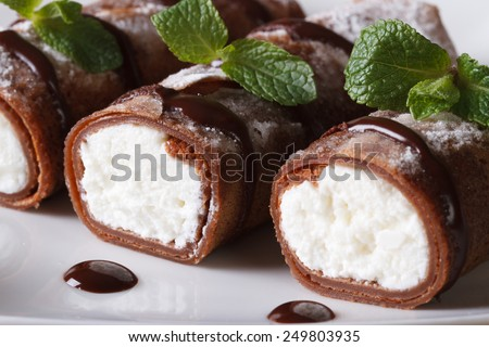 chocolate crepes with ricotta cheese on a plate macro horizontal  - stock photo