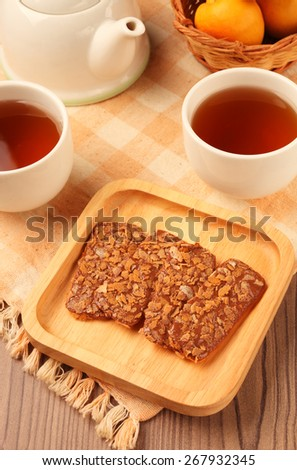 Chocolate crunch  and tea cup served on the table   - stock photo