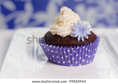 chocolate cupcake on a purple setting
