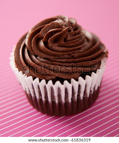 Chocolate Cupcake on Striped Background - stock photo
