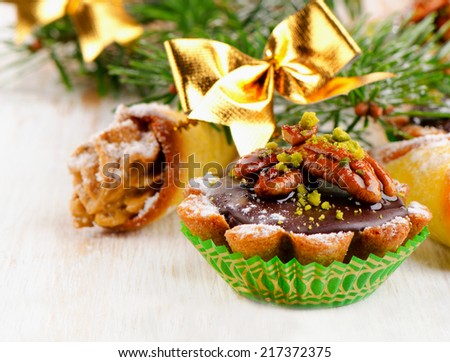 Chocolate Cupcake with Christmas decoration  on a wooden table. Selective focus
