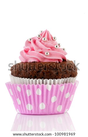 Chocolate cupcake with pink buttercream isolated over white background - stock photo