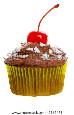 Chocolate cupcake with snowflakes and cherry on top - stock photo