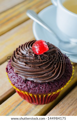 Chocolate cupcake with white cup tea - stock photo