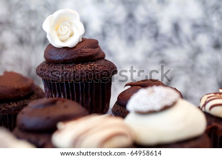 Chocolate Cupcakes Against An Elegant Background, focus is on the back cupcake