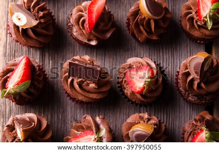 Chocolate cupcakes. Cupcakes. Cupcakes with strawberries. Top view. - stock photo