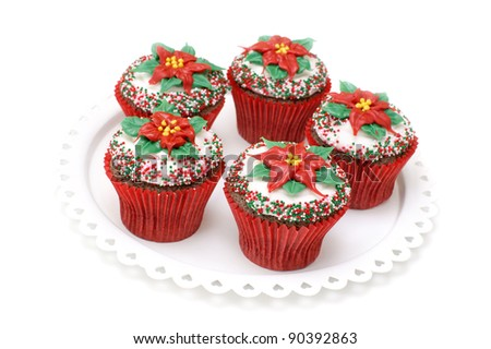Chocolate cupcakes decorated with Poinsettias - stock photo