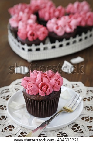 Chocolate cupcakes with pink vanilla buttercream rosebuds