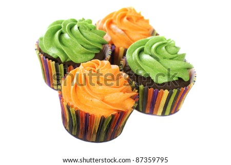 Chocolate cupcakes with vanilla frosting colored in bright colors. - stock photo