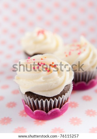 Chocolate Cupcakes with Vanilla Icing and Sprinkles - stock photo