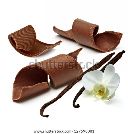 Chocolate Curls With Vanilla Beans On White Background - stock photo