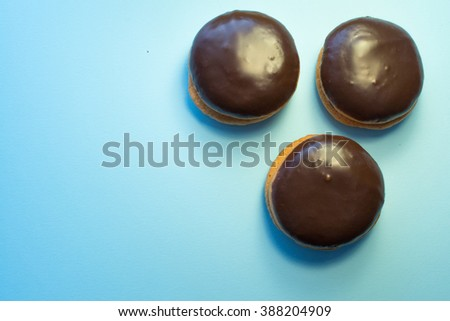 Chocolate dessert sweet cakes on blue background