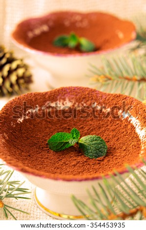 Chocolate dessert with cocoa and Mint. Christmas decorations, selective focus