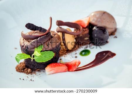 Chocolate dessert with ice cream and cookies. Restaurant - stock photo