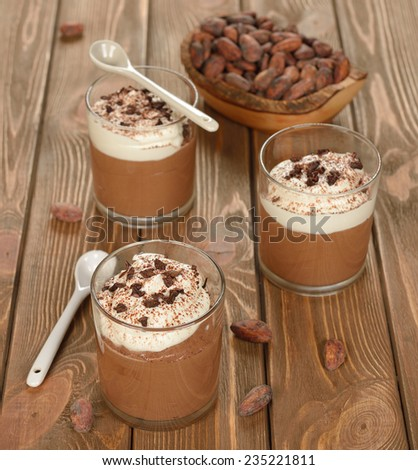 Chocolate dessert with whipped cream on a brown background - stock photo