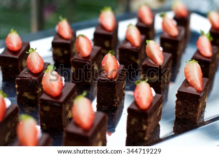 Chocolate desserts with strawberries at buffet in a restaurant - stock photo