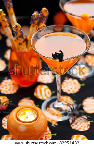 Chocolate Dipped Pretzels and drinks for Halloween - stock photo