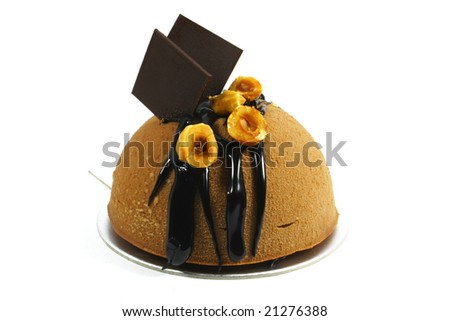 chocolate dome cake decorated with hazelnuts - stock photo