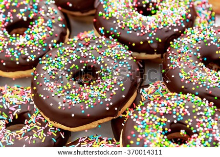 Chocolate donuts with chocolate shavings color on a traditional craftsman market.Horizontal image.