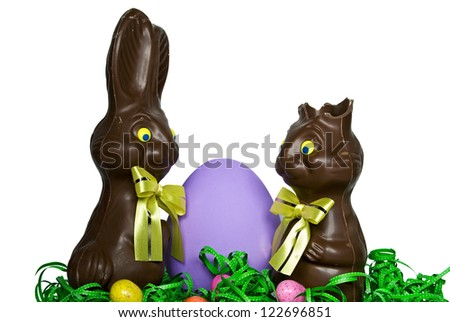 chocolate easter bunny with purple egg - stock photo