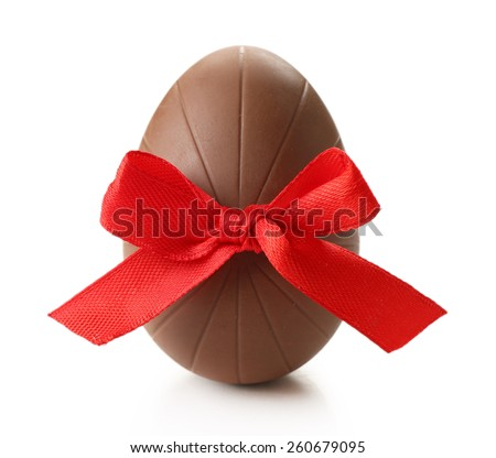 Chocolate Easter egg with color ribbon bow isolated on white - stock photo