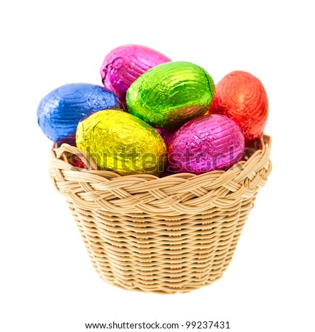 chocolate easter eggs in colorful foil on white background - stock photo