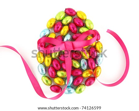 Chocolate Easter eggs in colorful foil with a bow