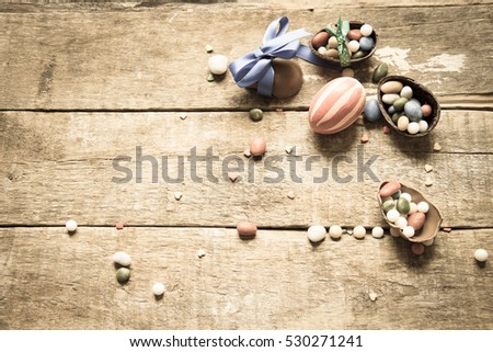 Chocolate Easter Eggs Over Wooden Background, toned photo