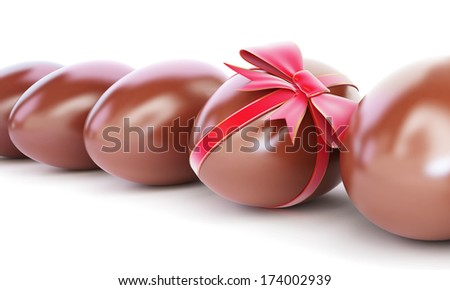 chocolate egg with bow on a white background - stock photo