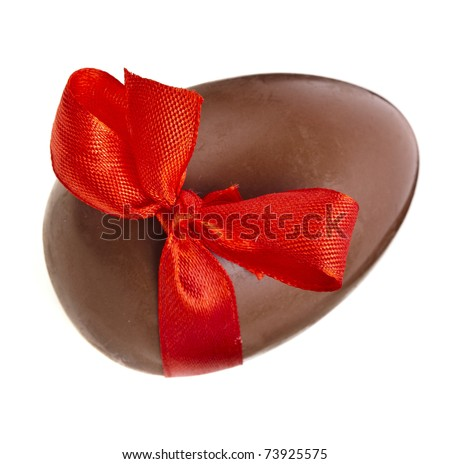 Chocolate egg wrapper a red ribbon bow close up  isolated on white background  - stock photo