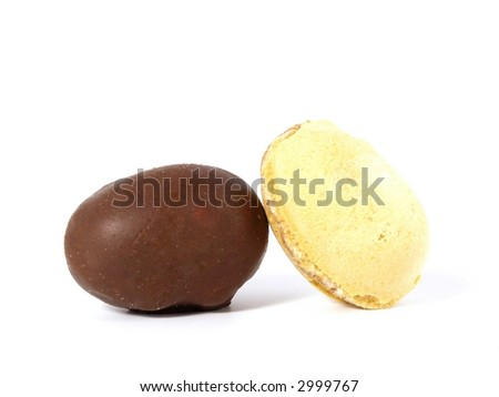 chocolate eggs and wafel eggs isolated on white background - stock photo
