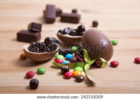 Chocolate Eggs on Wooden Background - stock photo