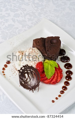 Chocolate flan with strawberries and chocolate, a wonderful dessert - stock photo