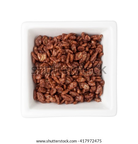 Chocolate flavored breakfast cereal in a square bowl isolated on white background - stock photo