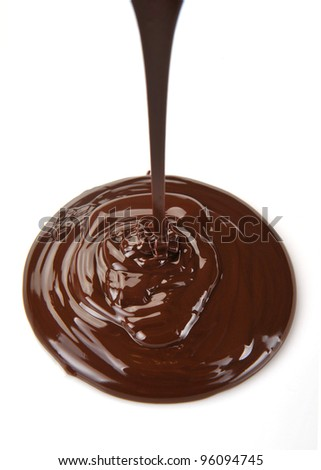 Chocolate flow isolated on white background - stock photo