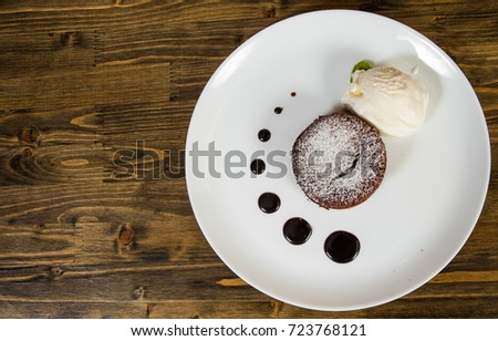 chocolate fondant on a wooden background. with copy space. top view