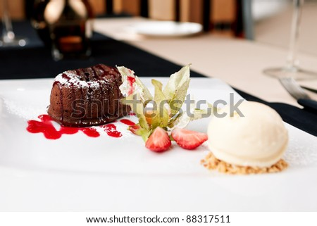 Chocolate fondant with vanilla ice cream and raspberry sauce - stock photo