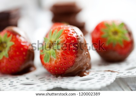 Chocolate fondue with fresh strawberries, selective focus - stock photo