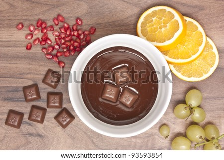 Chocolate fondue with fruits - stock photo