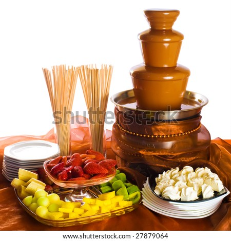 Chocolate fondue with fruits and zephyrs - stock photo